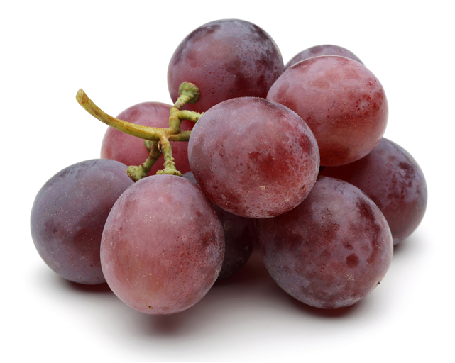 Red grapes close-up. Isolated on white background.